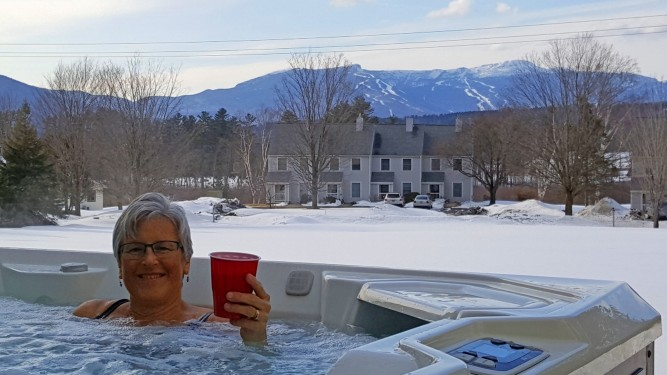enjoying the hot tub looking out on Mt. Mansfield